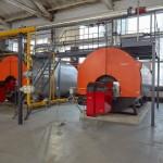 Произведена замена двух паровых котлов ДКВр 10/13 на два водогрейных котла мощностью по 6 МВт каждый, а также перевод третьего парового котла ДКВр10/13 в водогрейный режим, демонтаж паропроводов, замена действующего на тот момент насосного, теплообменного оборудования, монтаж новой дымовой трубы с отдельными газоходами для каждого котла.